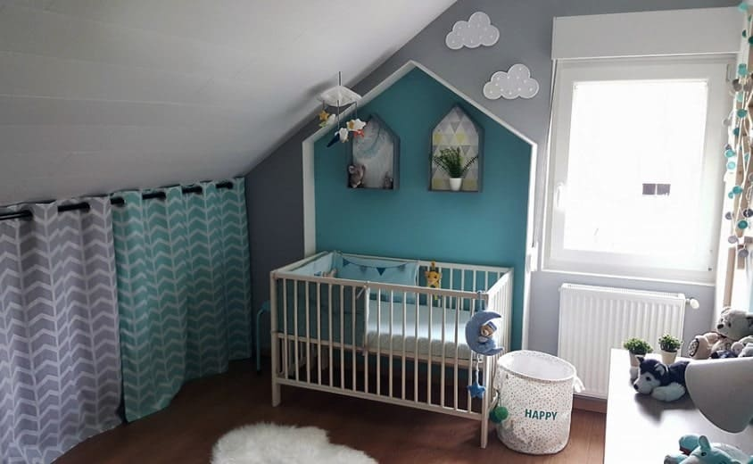 Small spaces can be tricky to decorate. But this beautiful, quaint little nursery uses teal and lavender to brighten up an otherwise darker themed room. If you want a creative, aesthetically pleasing way to hide any unpleasing storage spaces you have in the room, we love the subtle curtained cover. Not only does it look simple and add color, it is also functional!