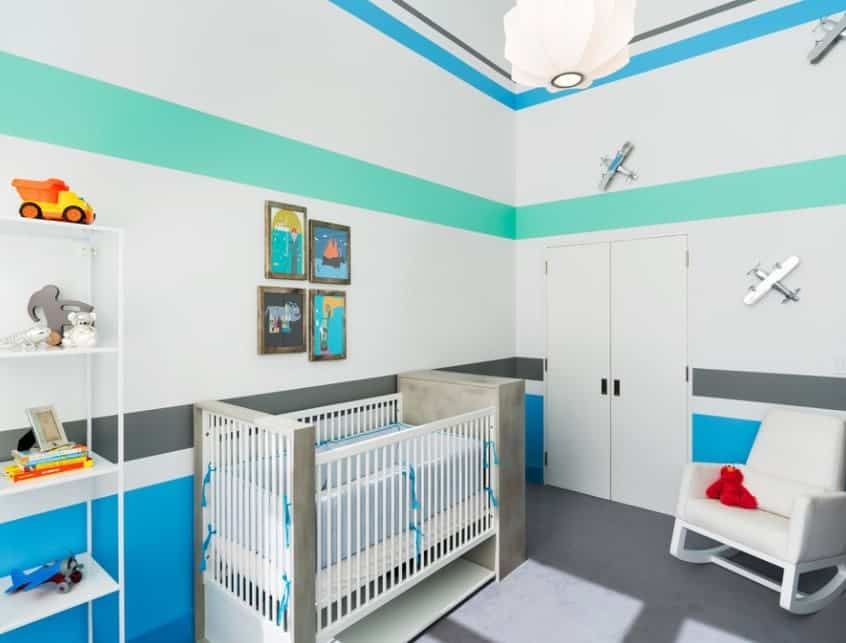 This is for those parents who want to add a little more color to their nursery without going overboard. The cooler tones of blue and teal could have looked like too much very fast but by keeping the paint minimal through bold stripes, the room gets a colorful, yet simplistic vibe that we love.