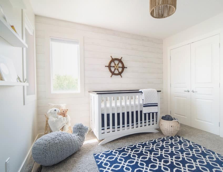 This is another great example of how simple accents can add a lot to the room but can just as easily be swapped out in the future for female babies. We love the coziness of the knitted animals.