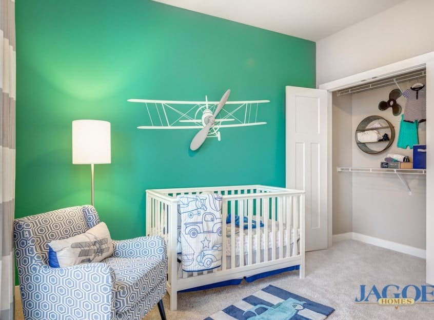 Don't be afraid to experiment with different complimenting colors. This brilliantly simple nursery uses a bright teal-green for one wall brining an otherwise simple room to life with a burst of color. You can always play around with other colors but choosing soothing tones like blue and green can help you and your baby feeling calmer.