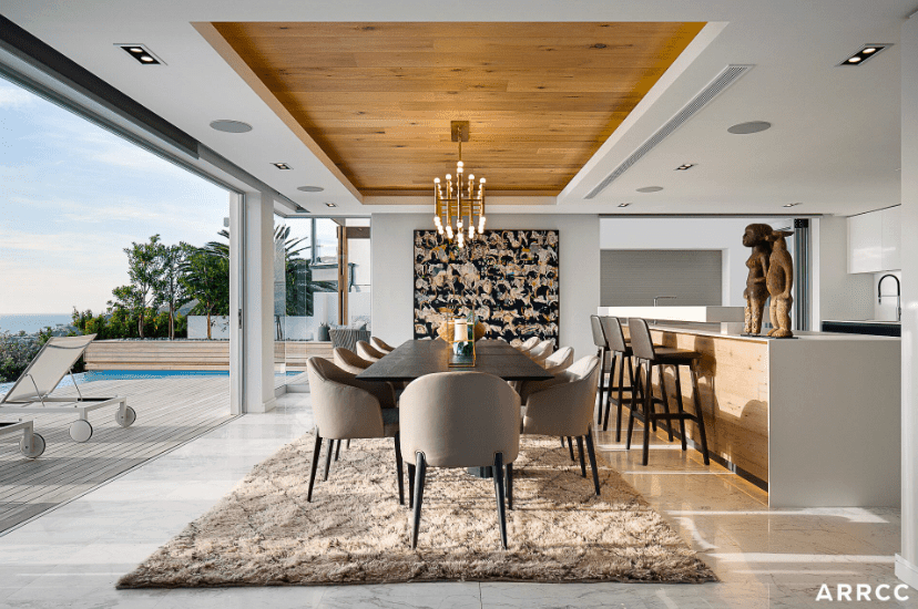 Dining room and kitchen by ARRCC