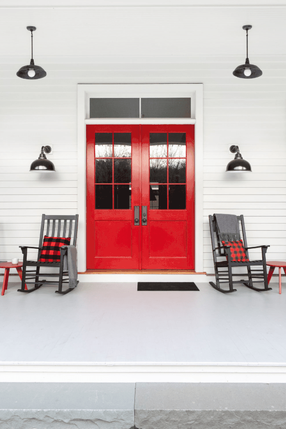 Double red front door with porch by chango & co.