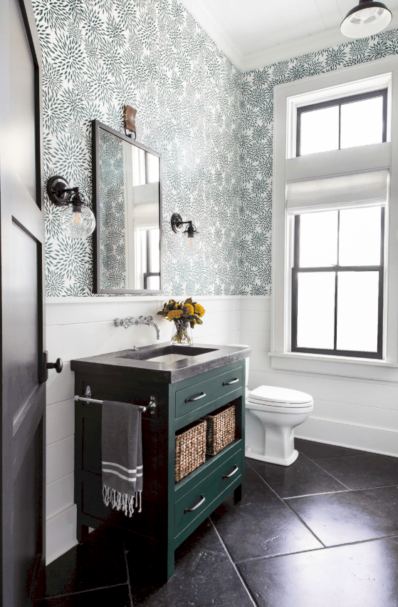 Farmhouse powder room with green vanity and wallpaper by chango & co.