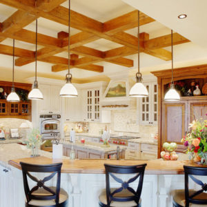 Large white kitchen with a curved kitchen island
