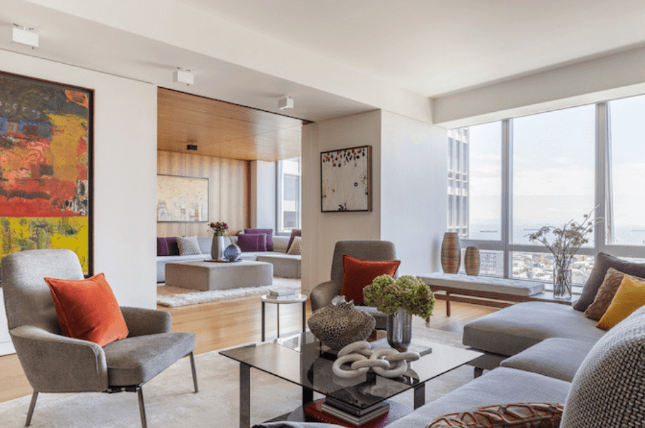Open concept kitchen and living room in luxury condo by DECOR AID