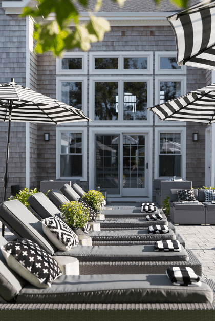 Before going inside, here's a close-up photo of the patio lounge chairs lined up around the pool.