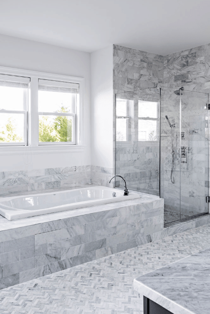 I saved the best for last, which is the magnificent master bathroom in white and gray. Check out the elaborate design which includes large tub and glass walk-in shower here.