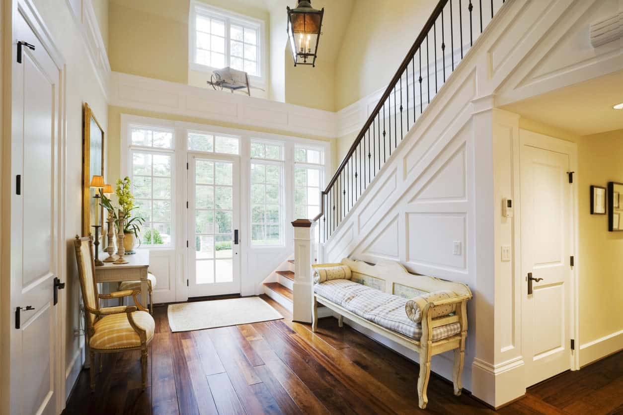 With a two-toned wooden floor and wooden stair treads, this house maintains the essence of the old wood-themed foyers. But what makes it fit for contemporary designs is the delicate railing and the use of excessively light colors for the walls and window frames.