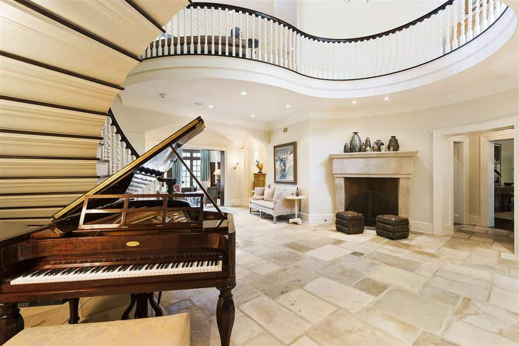 Keep it simple with a grand piano and few decorative vases like this foyer.