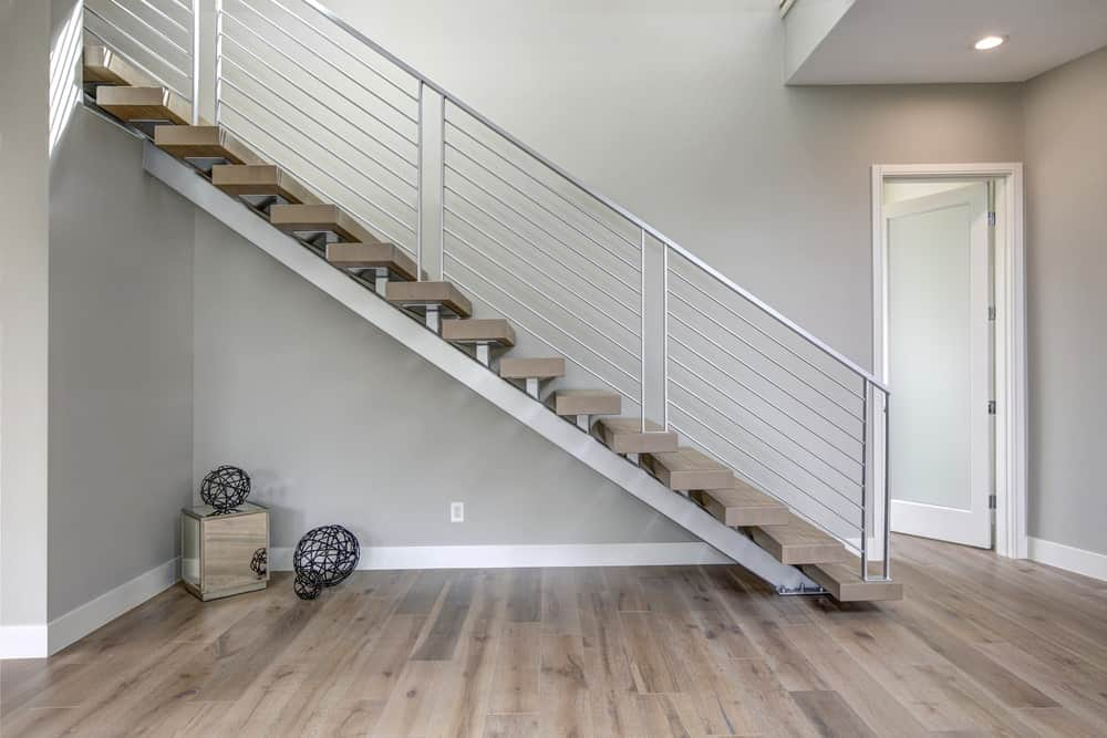 Simple foyer with a grayish hardwood flooring matching the gray walls.