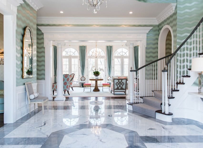 This home boasts a stunning foyer with sparkling bright tiles flooring and a lovely staircase lighted by a glamorous chandelier.