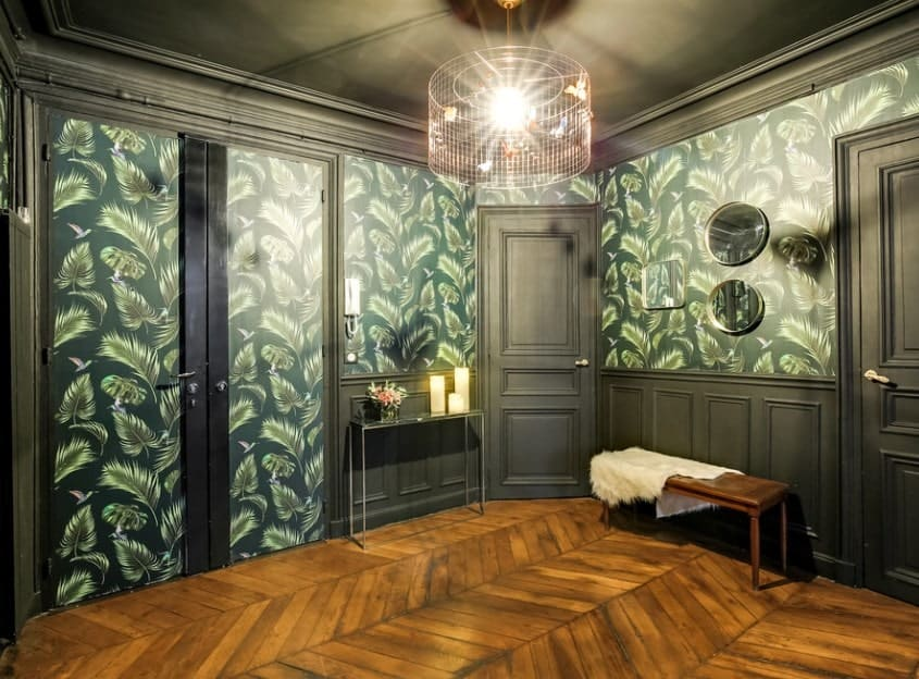 The very charming green walls with feathers design and black shade, together with the hardwood flooring make this foyer look so stunning.