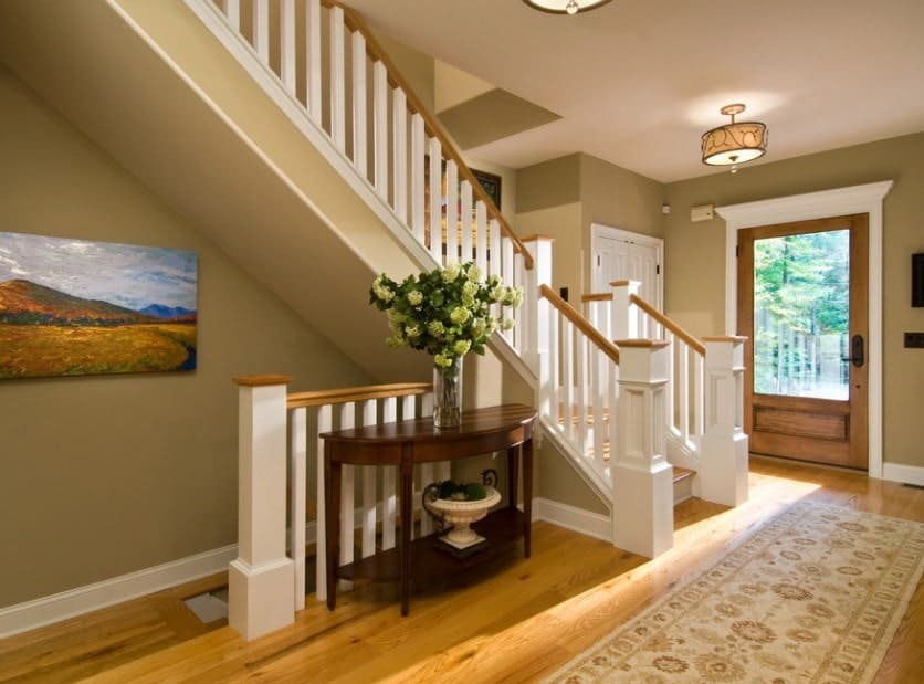 This home features a simple yet beautiful staircase along with the hardwood flooring and classy rug.