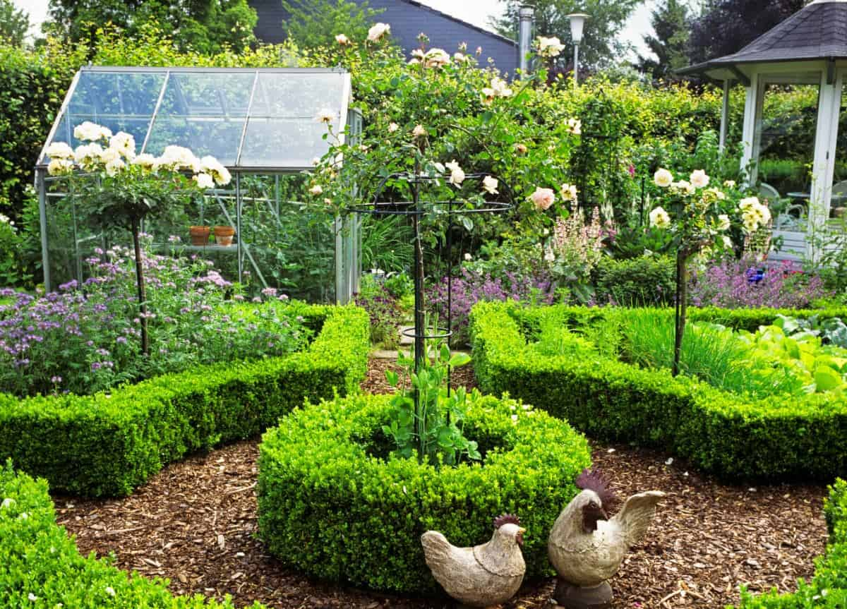 Knot garden with small greenhouse