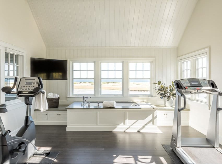 White is a really lovely color to make any room seem bigger. Home gyms can be great spaces if you don't feel claustrophobic.