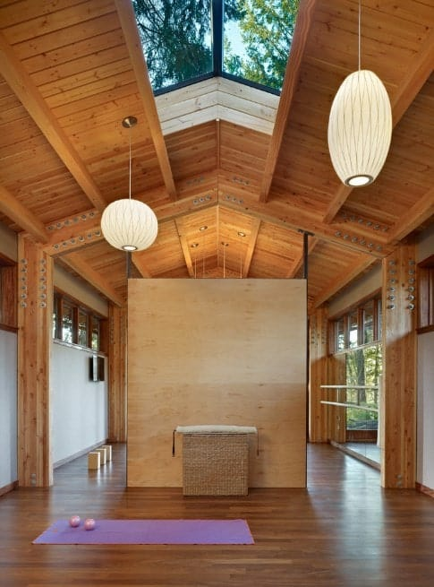Wooden panels look earthy and they can set a good mood to relax in for yoga exercises and meditation.