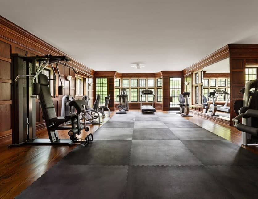 Grey and black carpeting also sets a more serious and rustic look to the home gym. This is especially true if you add some nice reddish brown wooden paneling.