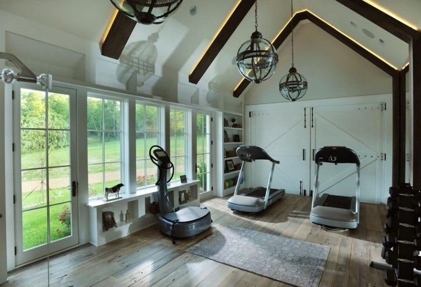 Decorate your home gym with nice accessories and shelves. This will make your home gym look really neat and organized.