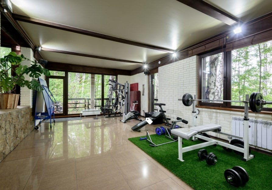 Fake grass sheets can be a great way to add some color to your home gym. If you choose a room with tiles, it can prevent the machines from skidding while you are working out.