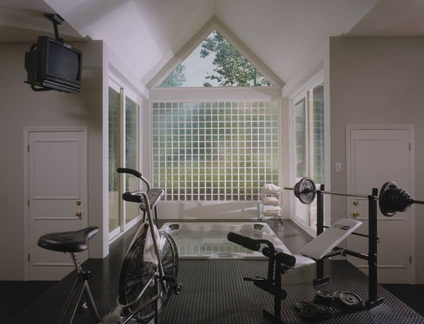 A hot water tub surrounded by windows overlooking the garden can be really soothing. You can install opaque glass to let the light in but but still maintain your privacy.