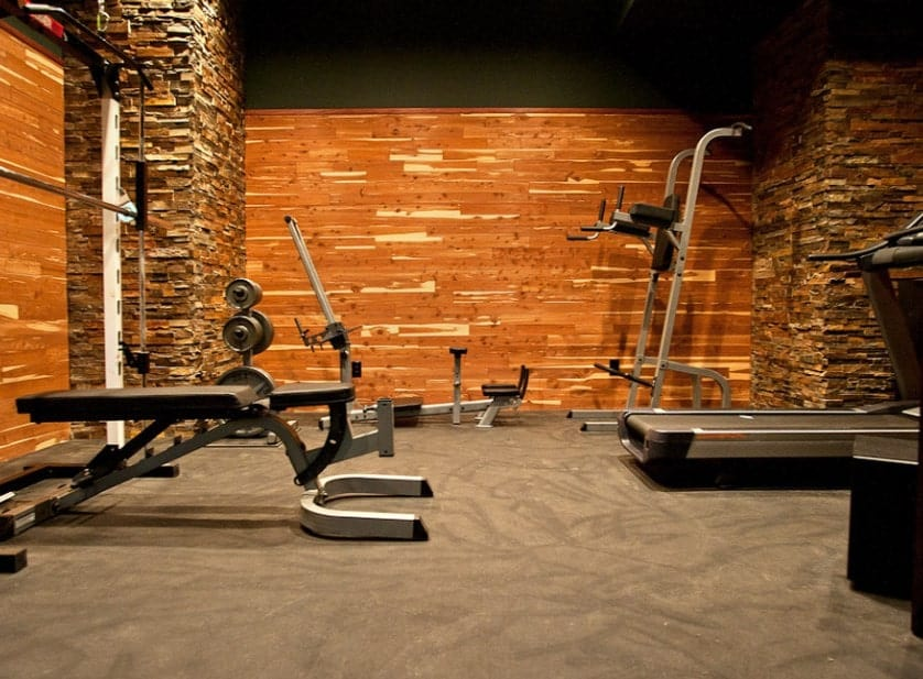 Uneven bricks and wood paneling can look really unique and rustic in your home gym. Use them to give the space an earthy look.