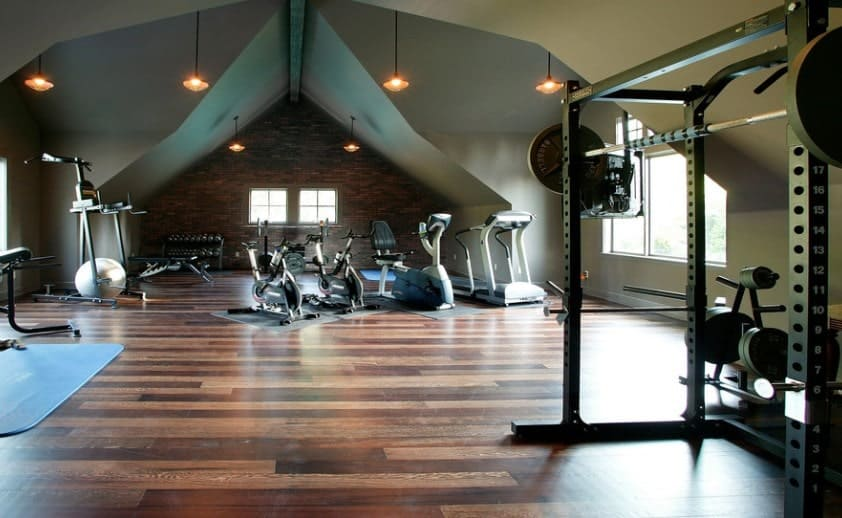 If you have a huge attic, use it to create yourself an amazing looking gym. You can use the landings of the roof as a styling opportunity.