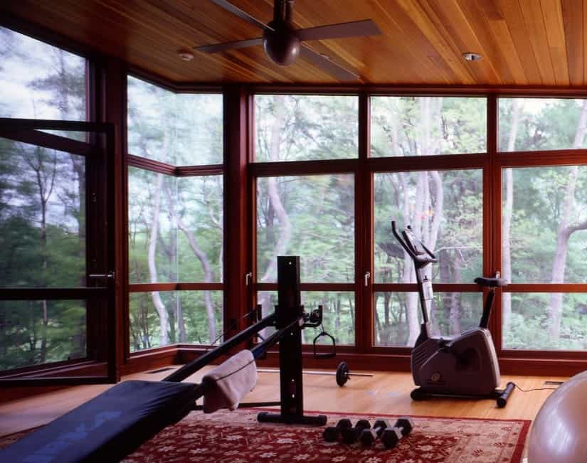 A nice rustic rug can add some color to the home gym and give it a more rustic feeling. It looks great against wood paneling.