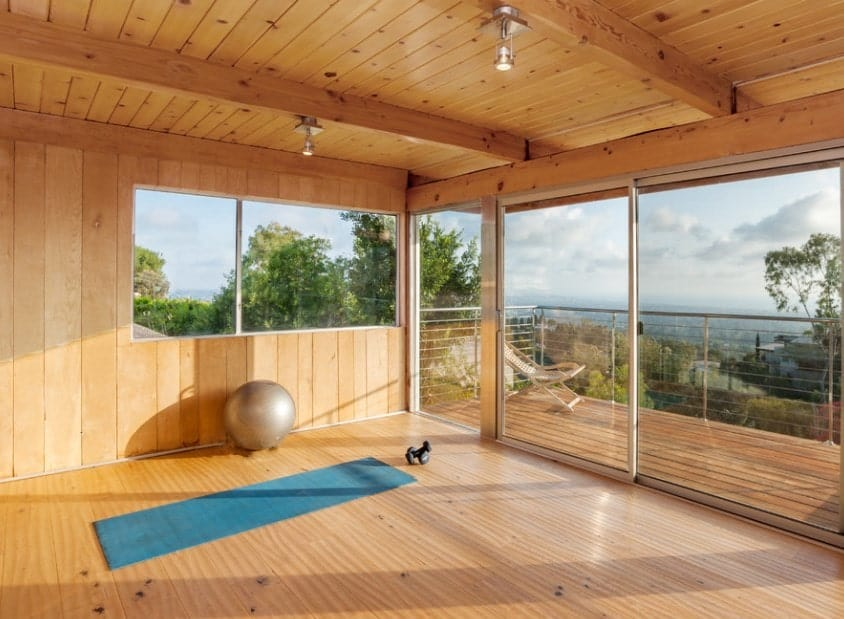 Add a balcony next to your home gym to get some fresh air after an intense workout. This will help get your heart rate down in a healthier way.