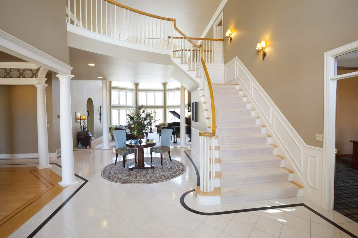 White large foyer with gold shade. The wall lighting adds style to the glamorous foyer.