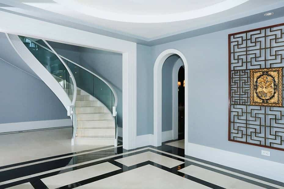 Another look of this large modern foyer featuring a stylish flooring, walls and staircase.