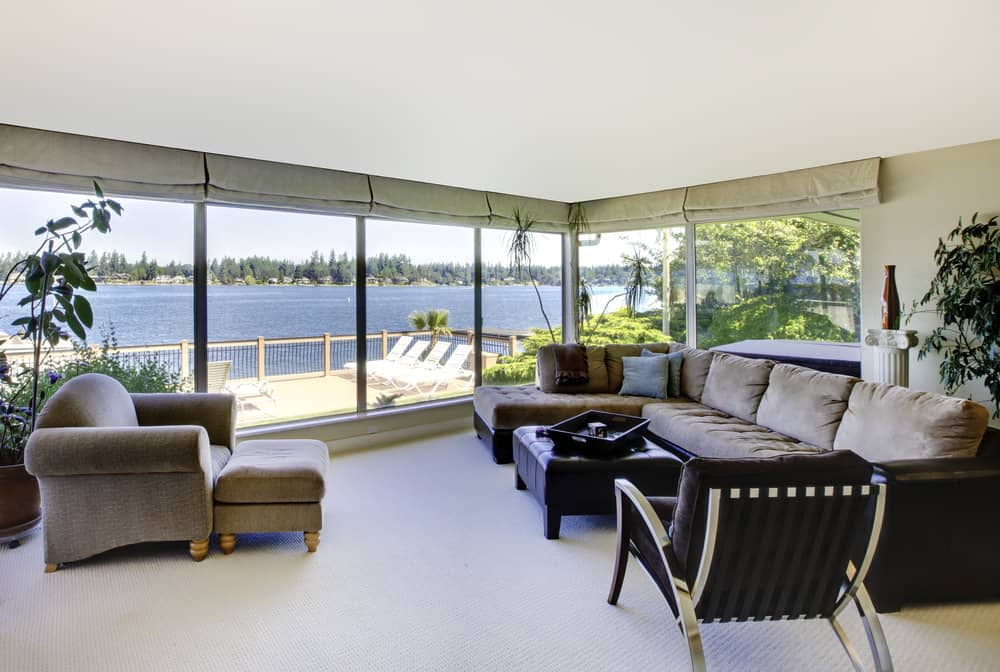If you want to experience the pleasure of walking barefoot in a living room that opens up to a stunning view like the image here, you need to install carpet flooring right now. You'll definitely thank us later!