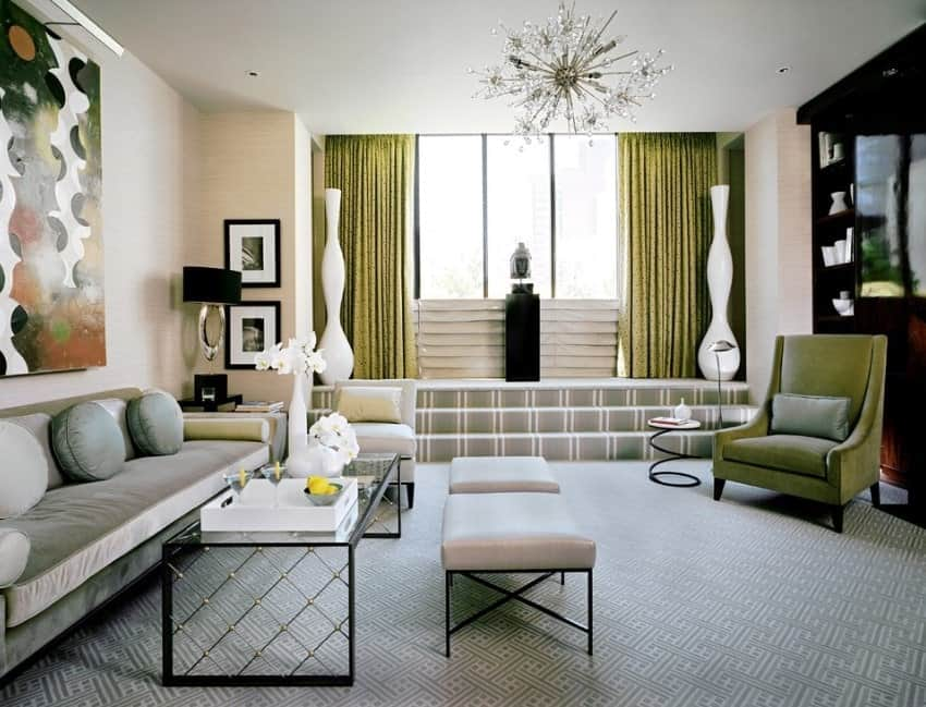 A classy living room featuring stylish carpet flooring and stunning ceiling lighting.