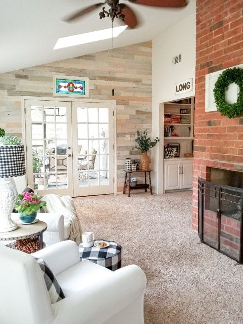This living room offers a fireplace and a set of white seats.