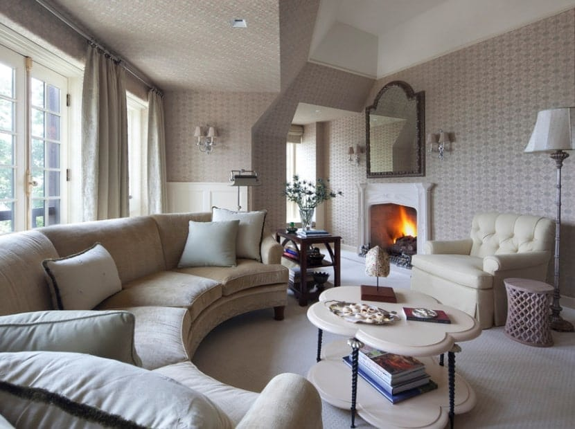 This living room boasts very attractive decorated walls and classy carpet flooring. There's a fireplace as well, keeping the place warm.