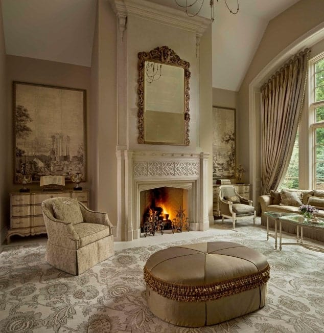 An elegant-looking living room with stunning carpet flooring and a handsome fireplace keeping the place warm. The seats are very elegant.