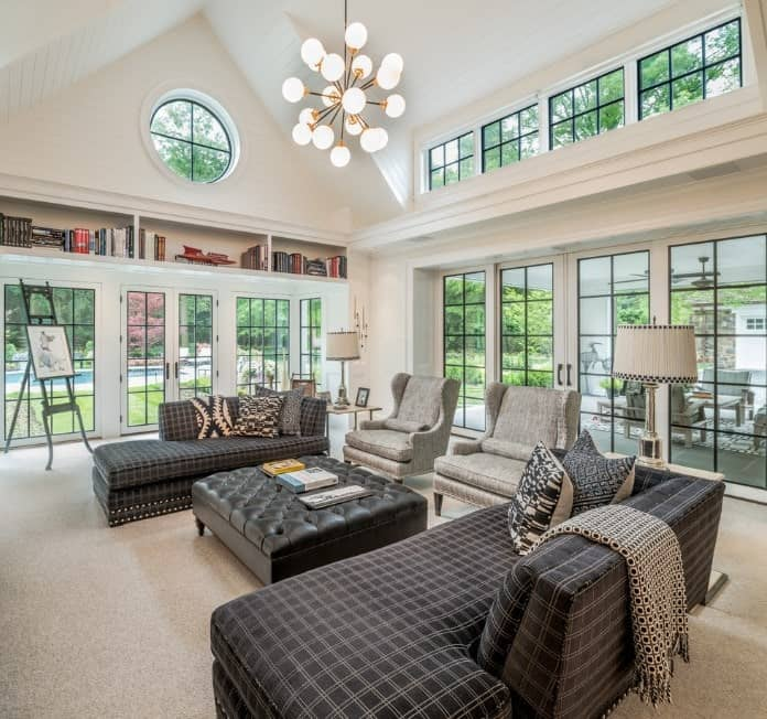 This living room is all about its unique patterned sofas. Let them be in the spotlight by having the rest of the elements modest and subdued including your living room carpet.