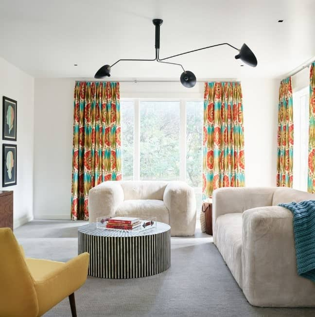 The elements may be different from one another yet they coordinate so well. Extra points for those colorful curtains!