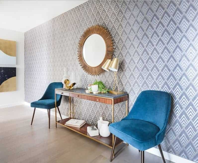 Mid-century foyer featuring a very stylish and classy wall. The wall decors are absolutely stunning. The light-finished hardwood flooring looks perfect too.