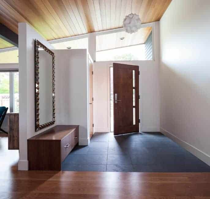 Mid-century foyer with white walls and hardwood ceiling. The pendant light looks nice for the foyer as well.