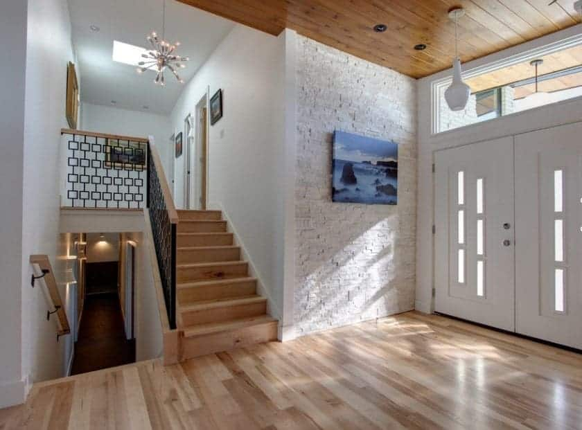 Mid-century foyer featuring white walls, vinyl flooring and a hardwood ceiling.