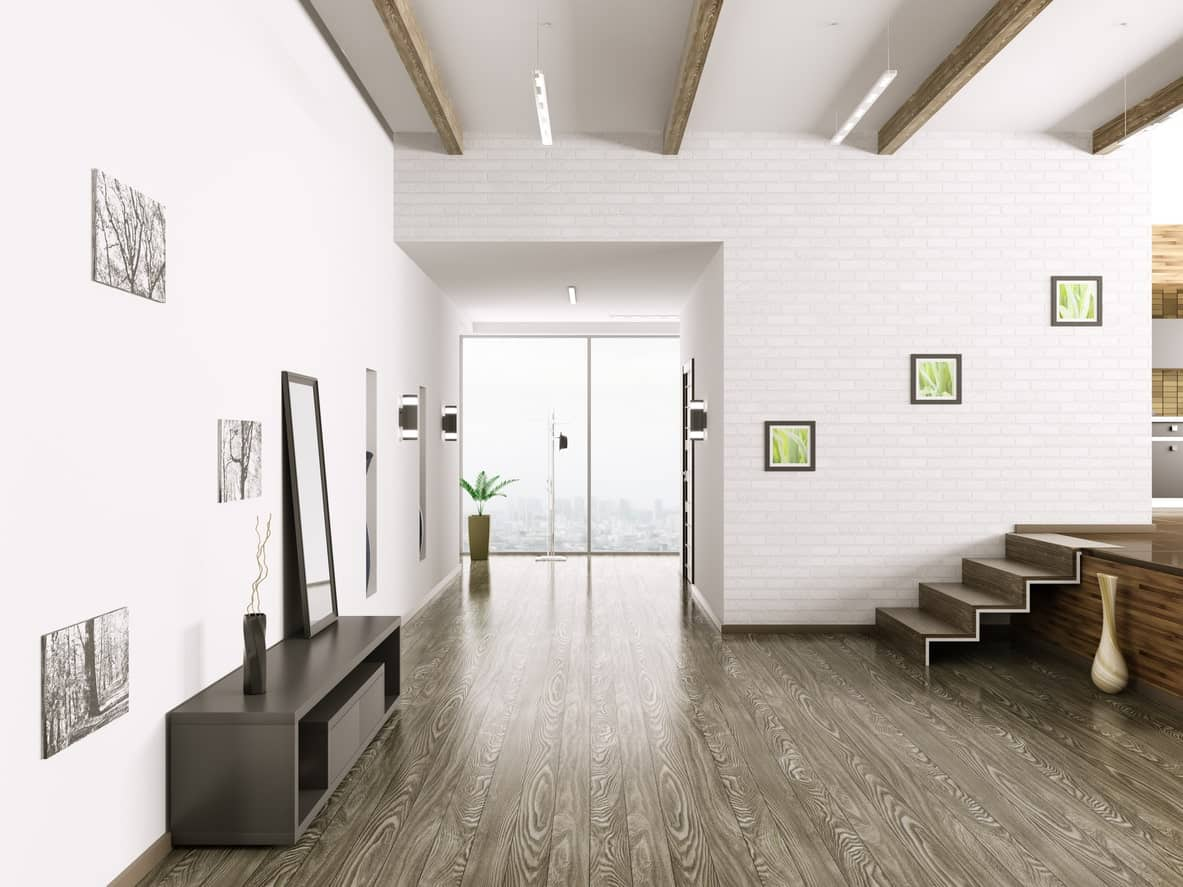 A very modish entry with a stylish flooring. The white walls and ceiling offers a perfect view of designs while the beams ceiling add style to the stunning home.