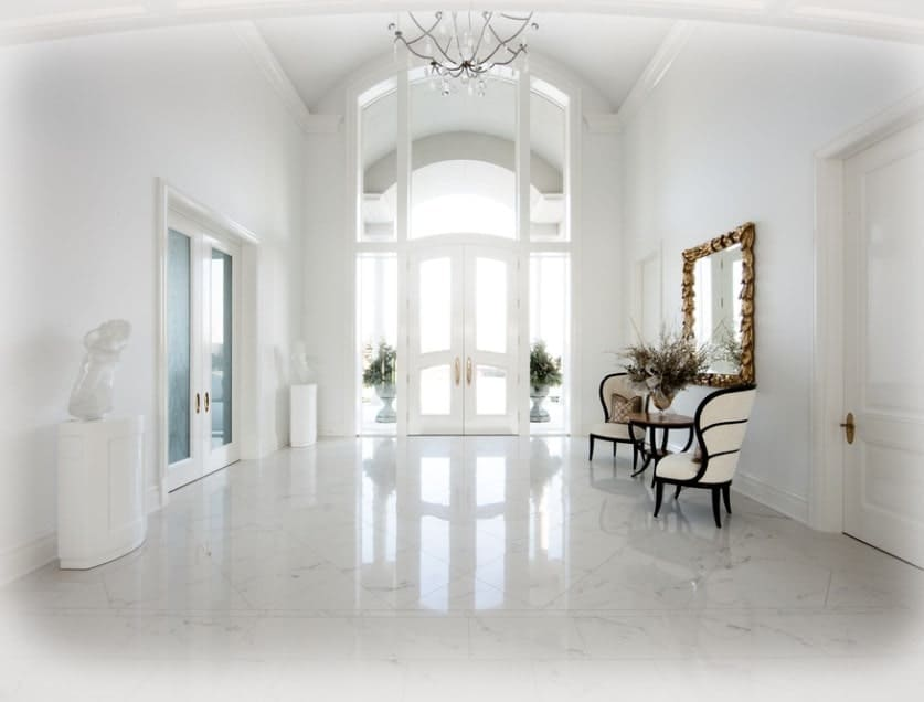 This pure white entry is like a fairy tale home. The white flooring, walls, ceiling and other details of the home look absolutely stunning.