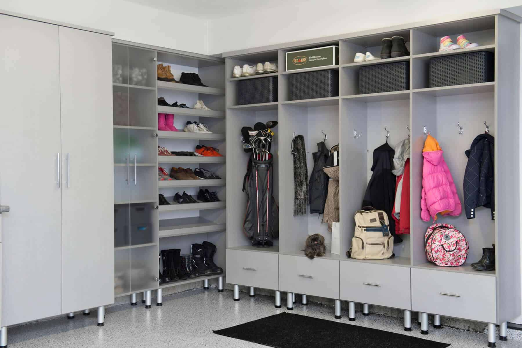 This has to be one of the most spacious and well-built mudrooms with separate compartments for almost everything including shoes, clothes, bags, etc. It also takes on a grey-theme, making it look more like a walk-in closet than a mudroom.