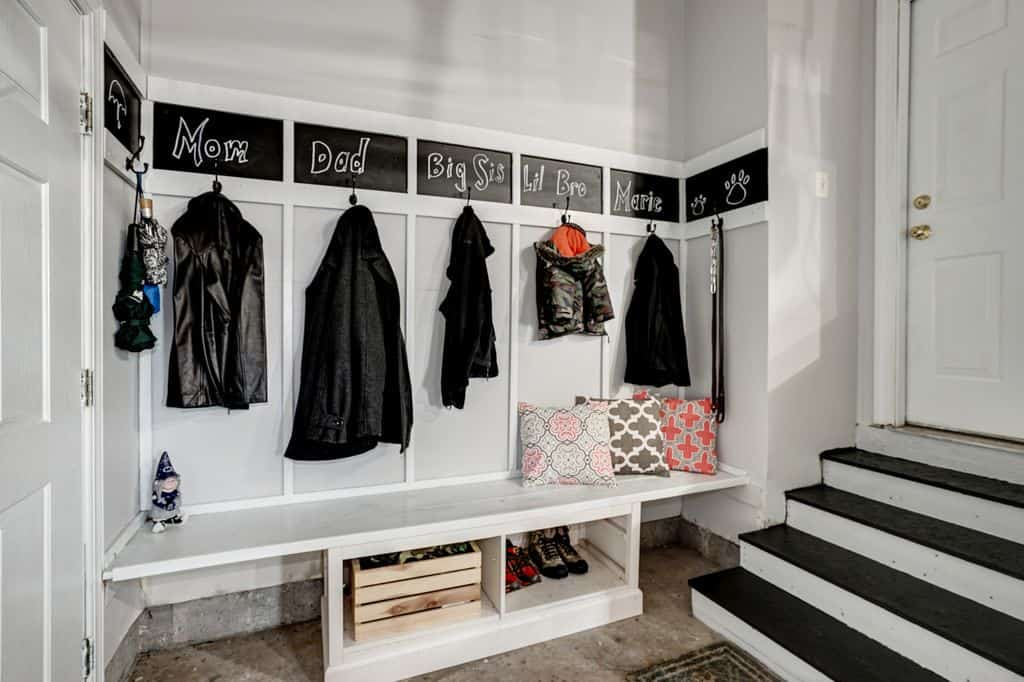 This is another unique mudroom idea with leading stairs and separate storage hooks assigned to every member of the family and very limited luggage compartments.