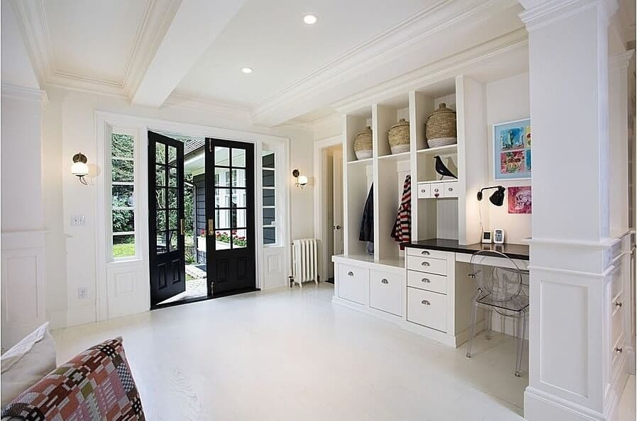 Just like a fully functional room, this mudroom is huge, with a proper entrance door, a tiny table with a chair and some storage compartments on the side.