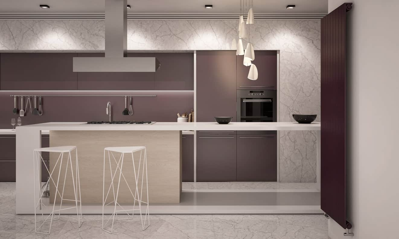This elegant style kitchen features a stylish color details and a narrow center island along with an elegant pendant light.