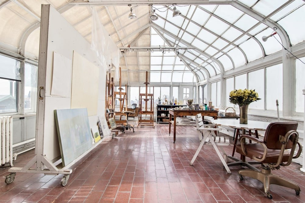 This is the greenhouse that is currently used as painting studio of the penthouse. It has glass walls that extend to the ceiling. Image courtesy of Toptenrealestatedeals.com.
