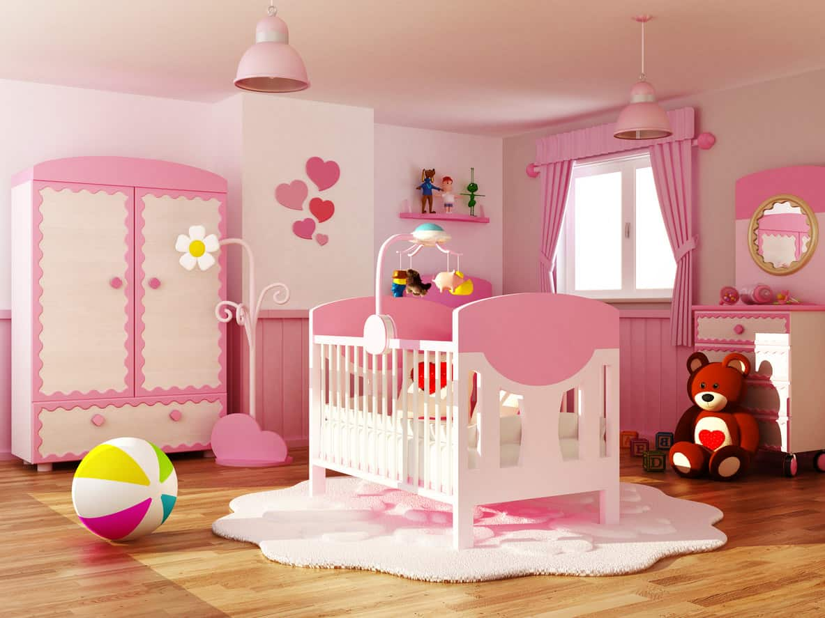 Sample design of a very bright pink baby room for girls with hardwood flooring. Crib in the center of the room.