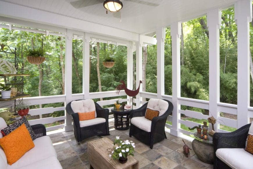 This is simply lavish, with a proper seating area containing cushions, pillars all around, and hanging plant-pots, all of it gives it a very grand look. The addition of squared flooring also furthers the whole look.