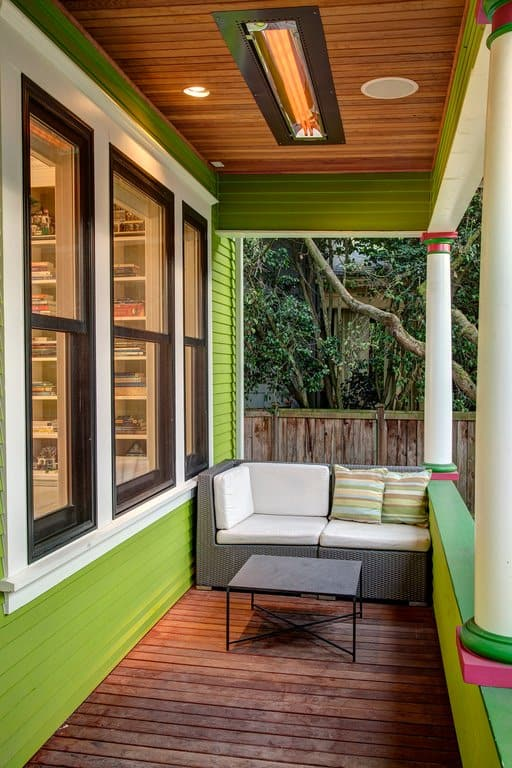 This is one of the funkier and most chic porch design and is full of colors, too. Apart from typical white pillars and wooden vinyl flooring, this porch has taken things up a notch with parrot green walls, dark green on the top and a touch of striking pink at the bottom of the pillar. It is small and compact for sure but is definitely stylish and unique.